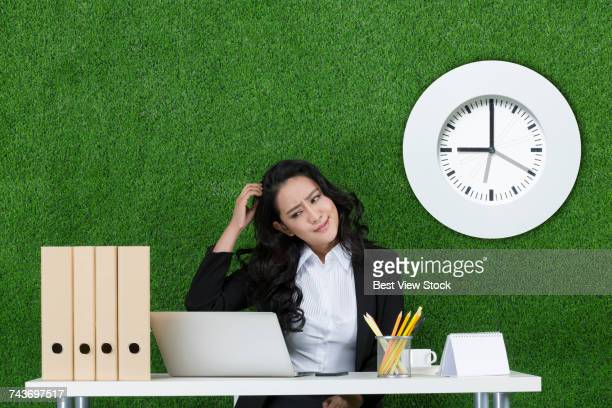 grass business woman and clock - extra long stock pictures, royalty-free photos & images