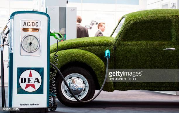 A grass covered mock VW electronic beetle car is pictured at the Hannover Messe industrial trade fair in Hanover central Germany on April 7 2014 The...