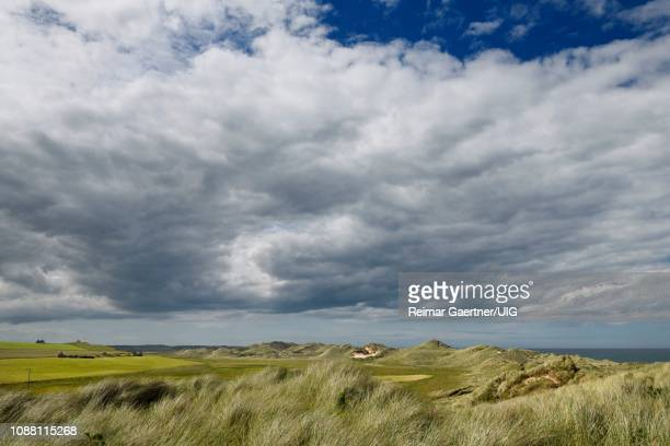grass covered sand dunes at rattray head on the north sea at seatown buchan aberdeenshire scotland uk with pillbox ruins old rattray - rattray head stock pictures, royalty-free photos & images