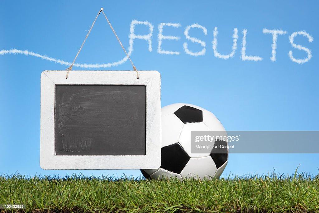 Grass, Footbal, Scoreboard, blue sky, clouds : Stock Photo