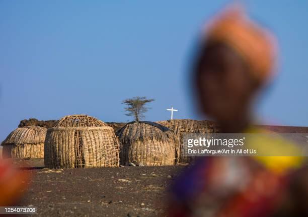 Grass huts and christian cross in el molo tribe village, Turkana lake, Loiyangalani, Kenya on July 15, 2009 in Loiyangalani, Kenya.