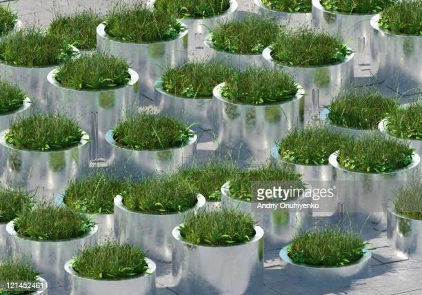 grass pattern in metal tubes - umweltschutz stock-fotos und bilder