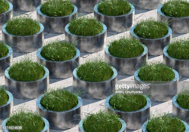 grass pattern in metal tubes - sustainability stock pictures, royalty-free photos & images