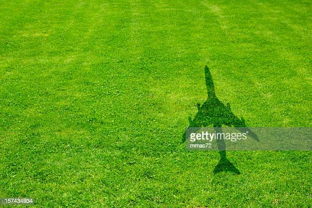 Grass with airplane shadow