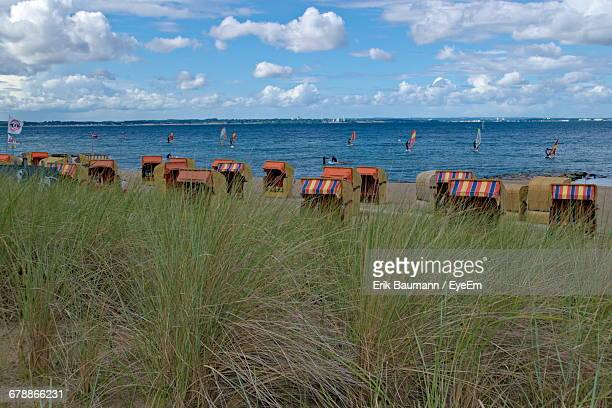 Grass With Hooded Beach Chair Overlooking Water