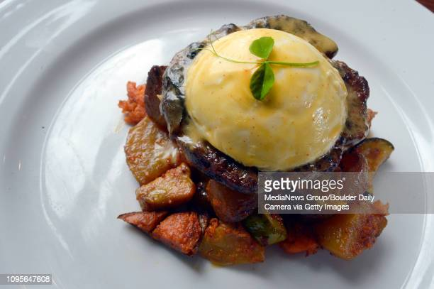 GrassFed Burger Benedict Smoky seasoned burger with hollandaise topped with a poached egg and hollandaise Served with sweet potato hashBlooming Beets...