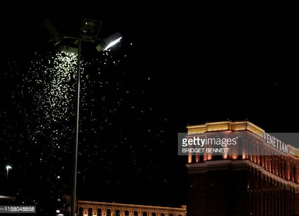 Grasshoppers swarm a light a few blocks off the Strip on July 26 2019 in Las Vegas Nevada Massive swarms of grasshoppers have descended on the Las...