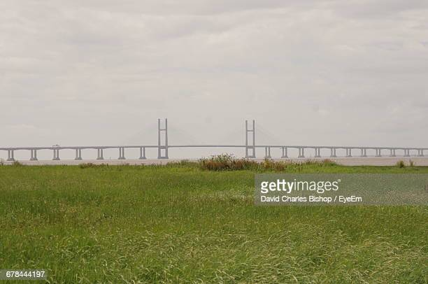 Grassy Field Against Second Severn Bridge Over Severn River