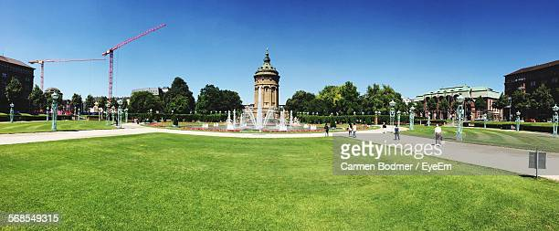 Grassy Field In Front Of Mannheim Water Tower Against Clear Blue Sky
