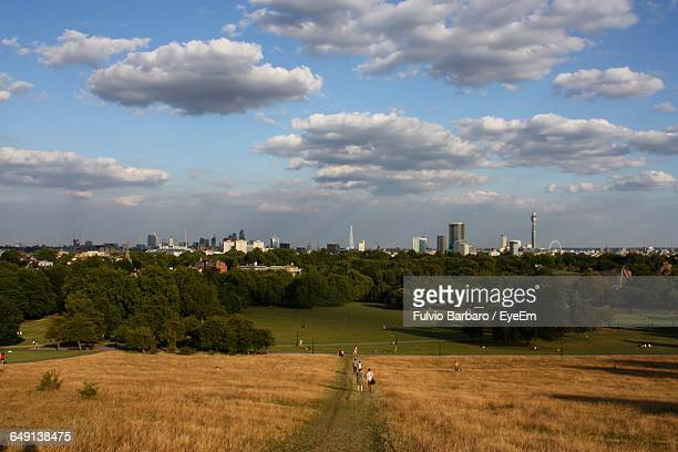 Grassy Landscape Against Cloudy Sky At Primrose Hill