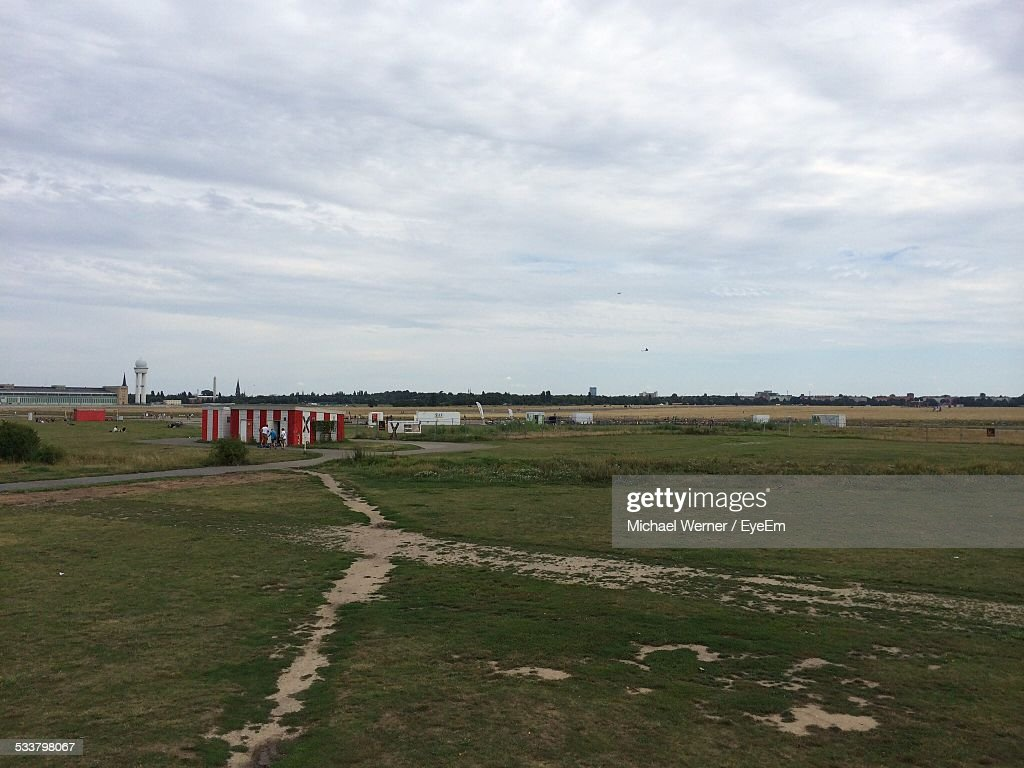 Grassy Landscape Against Cloudy Sky : Foto stock