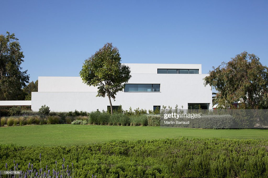 Grassy lawn near modern building : Stock Photo