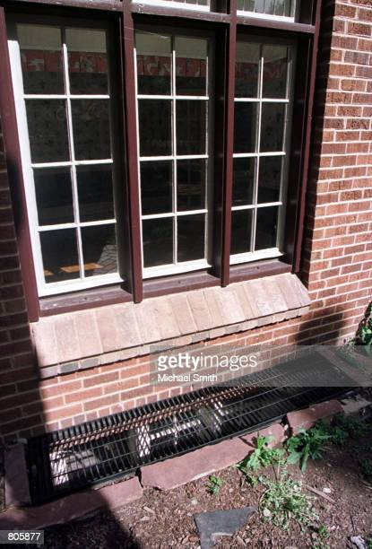 A grate covers a basement window at the home of John and Patsy Ramsey April 30 2001 in Boulder CO Retired investigator Lou Smit who was involved in...