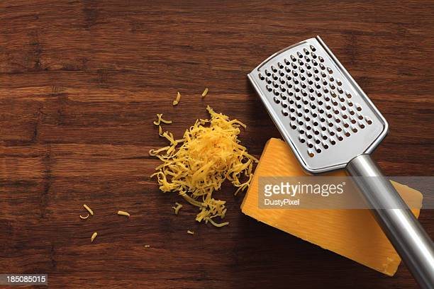 grated cheddar cheese - cheddar cheese stock photos and pictures
