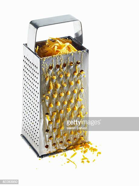 Grated cheese inside grater