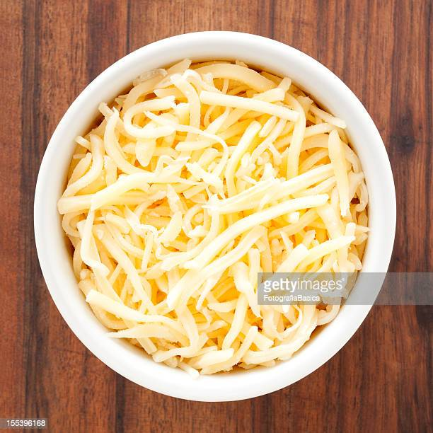 grated cheese - cheese stock pictures, royalty-free photos & images