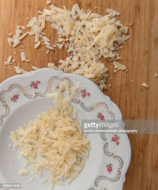 Grated Parmigiano-Reggiano in decorated plate.
