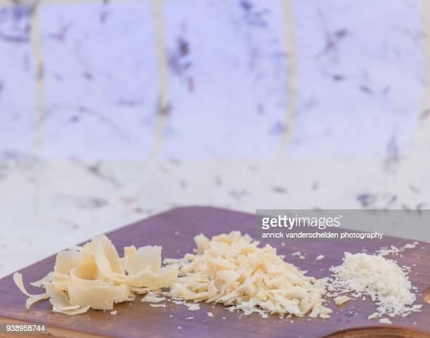 grated parmigiano-reggiano. - parmesan cheese stock pictures, royalty-free photos & images