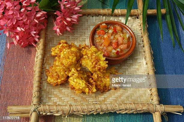 Grated tostones are loosely formed and fried just once