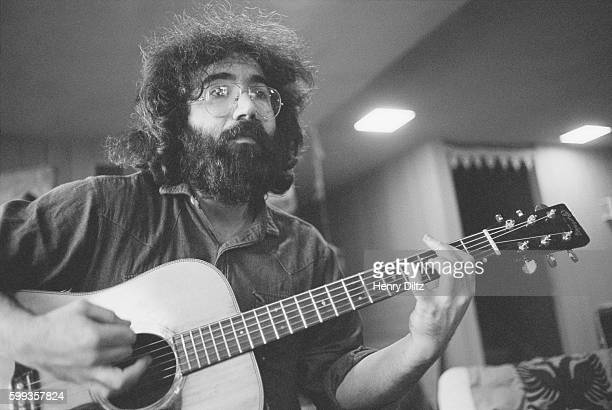 Grateful Dead frontman Jerry Garcia plays an acoustic guitar during a rehearsal jam session at the home of Grace Slick and Paul Kantner in Bolinas...