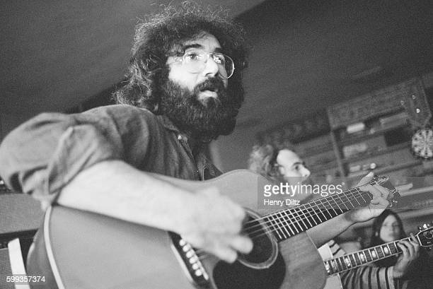 Grateful Dead frontman Jerry Garcia sits beside David Crosby during a rehearsal jam session at the home of Grace Slick and Paul Kantner in Bolinas...