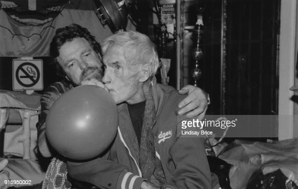 Grateful Dead lyricist and Electronic Freedom Foundation cofounder John Perry Barlow administers a balloon filled with nitrous for pain relief to...
