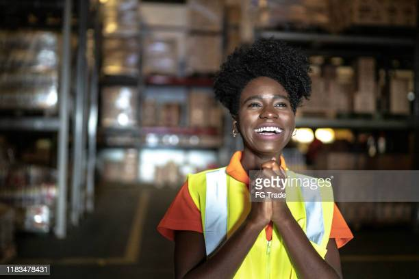grateful young woman worker at warehouse - gratitude stock pictures, royalty-free photos & images