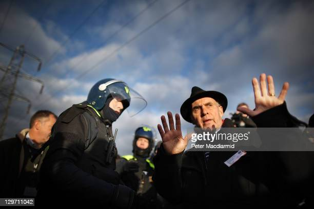Grattan Puxon from The Gypsy Council negotiates with a policeman during evictions at Dale Farm travellers' camp on October 20 2011 in Basildon...