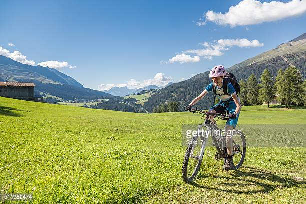 graubünden grass biking, switzerland - cross country cycling stock photos and pictures