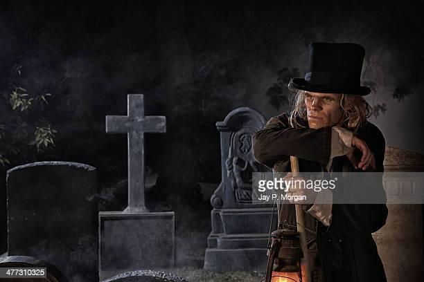 Grave digger at grave yard