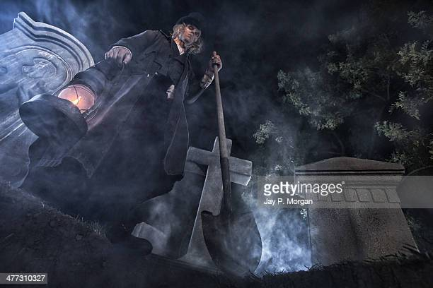 Grave digger standing over grave