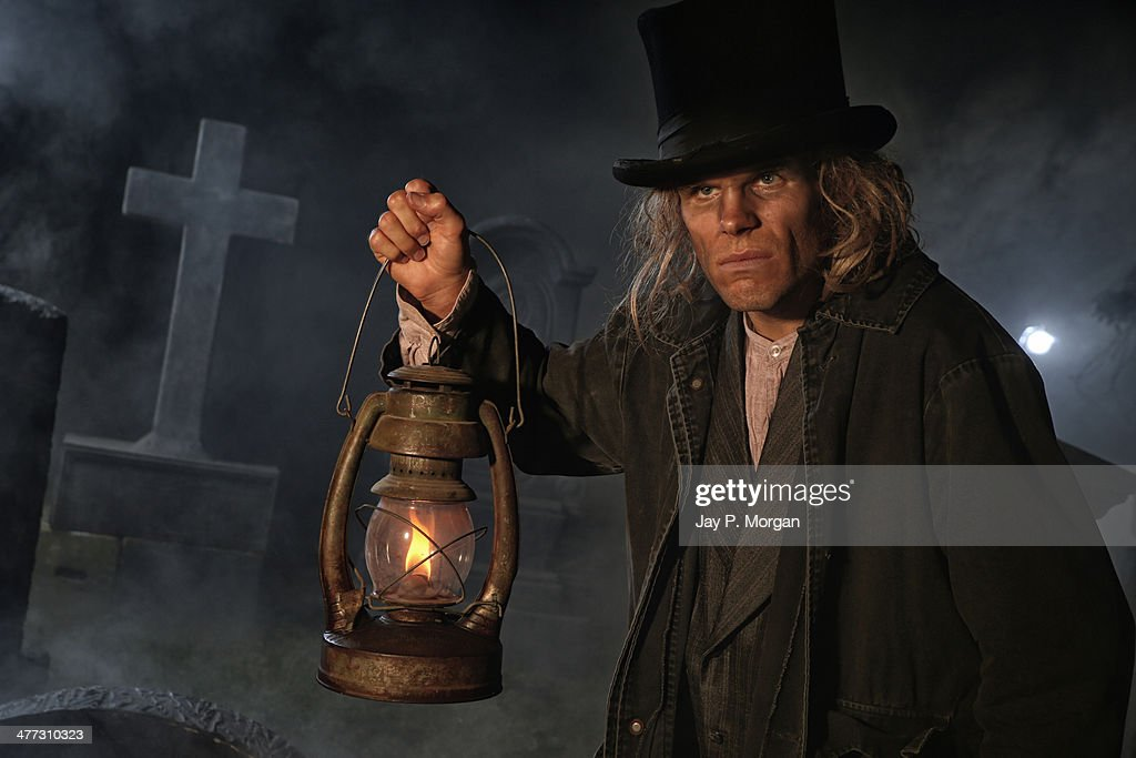 Grave digger with lantern : Stock Photo