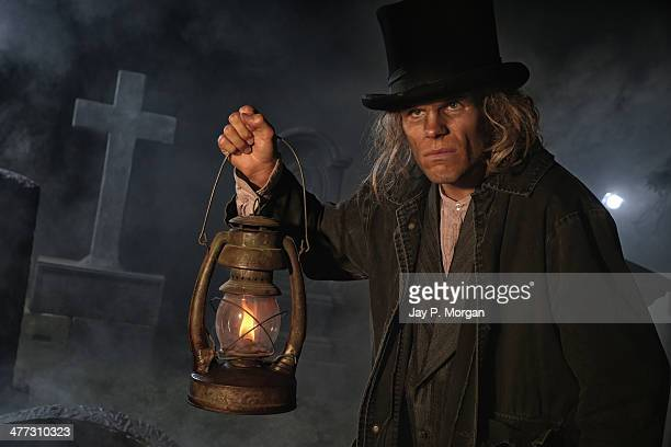 Grave digger with lantern