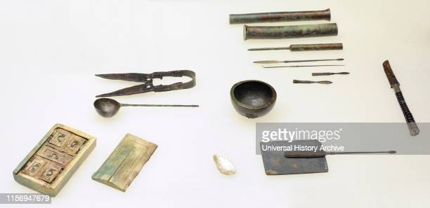 two scalpels three probes with bronze a catheter ivory medicine chest slate palette for grinding ointment ingredients bronze bowl for mixing...