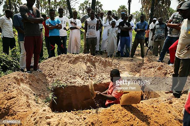 Grave is dug for the body of a man killed in a confrontation the previous evening is buried at his muslim funeral on June 28, 2015 in Bujumbura,...