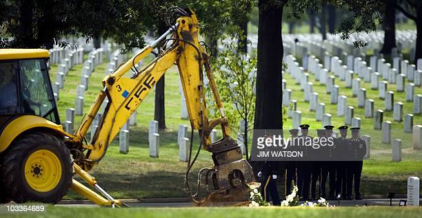 Grave is filled in by backhoe at section 60 of Arlington National Cemetery in Washington, DC, August 11, 2010. As of today, there are 469 casualties...