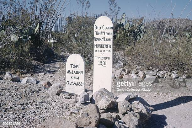 Grave markers for Tom McLaury, Billy Clanton, Tom McLaury, and others, Tombstone, Arizona, 1966.