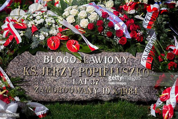 Grave of Father Jerzy Popieluszko on the day of the Holy Mass on October 19 2014 at the Church of Saint Stainslaw Kostka in Warsaw Poland The Holy...