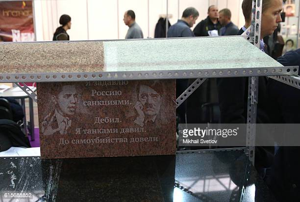 Grave plaque with portaits of US President Barack Obama Nazi leader Adolf Hitler and antiUS slogans is presented at the Necropolis Tanexpo World...