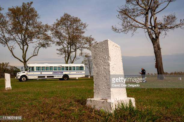 Grave site markers indicating plots of individual lots of buried remains stand on Hart Island on October 25, 2019 in New York City. Hart Island,...