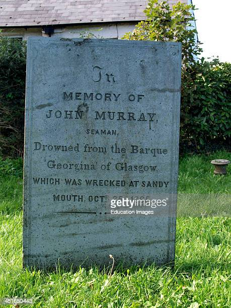 Grave stone at St Olaf church Poughill Bude of seaman John Murray who drowned when the Barque Georgina of Glasgow was wrecked at Sandymouth Bude...