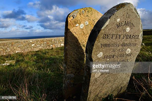 A grave stone in the Auld Kirk of a former resident Betty Fraseron the Island of Foula September 30 2016 in Foula Scotland Foula is the remotest...