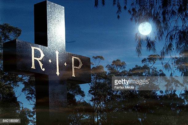 A grave stone lit up by a full moon 3 July 2007 AFR Picture by ROB HOMER