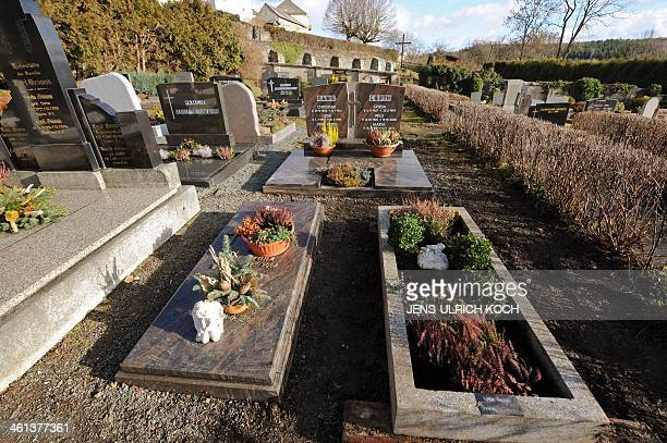 A grave that was opened on January 8 2014 in connection with the case of a girl missed since the year 2001 is seen at the cemetery of Lichtenberg...