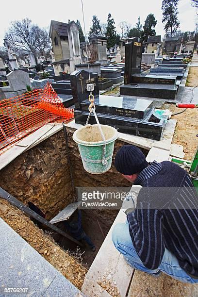 Gravedigger at the famous montparnasse cemetary in Paris FEBRUARY 25 2009