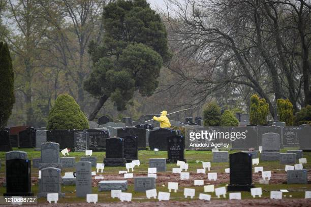 Gravedigger is seen at the Mount Richmond Cemetery which receives Covid-19 deaths in the Staten Island borough of New York, United States on April...
