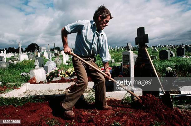 Gravedigger Shoveling Dirt