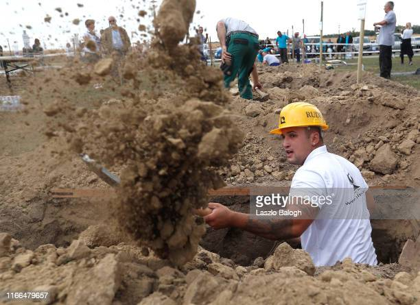 Gravedigger takes part in the 4th Hungarian grave digging championship on September 7, 2019 in Szekesfehervar, Hungary. Gravediggers have been...