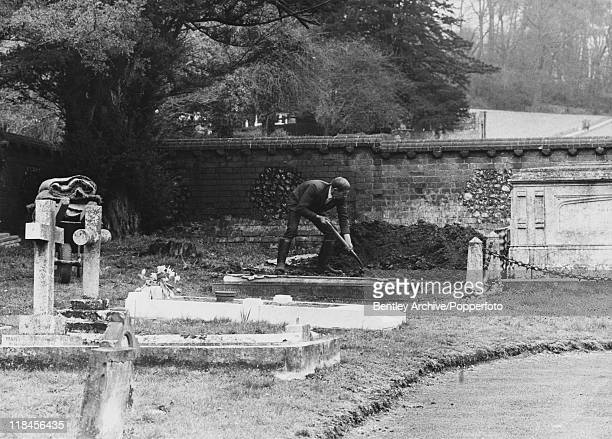 A gravedigger tending the unmarked grave of Ruth Ellis after the reburial of her body at St Mary's Church in Amersham Buckinghamshire 2nd April 1971...