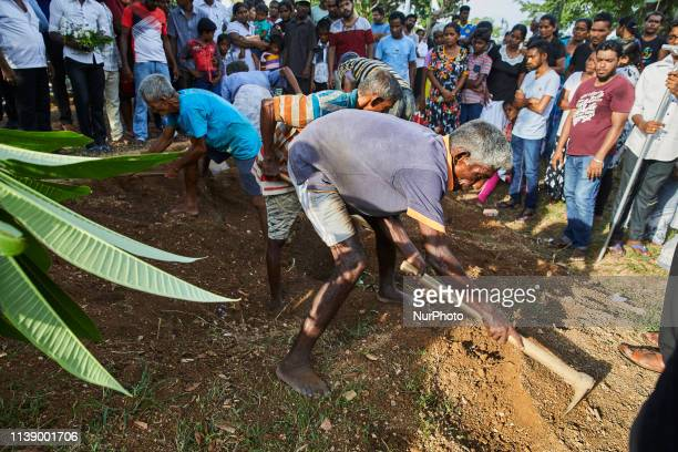 Gravediggers putting the soil over the casket of deceased, Loganathan Ramesh, 31 yrs old. Loganathan died on April 21,2019 in the St.Anthony's Bomb...